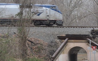 Amtrak_train_at_Colchester_Overpass_aka_Bunnyman_Bridge