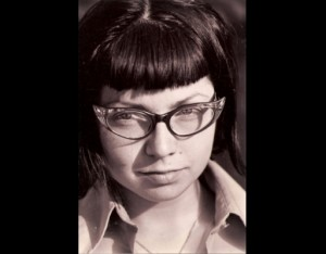 Skye with 60s glasses headshot